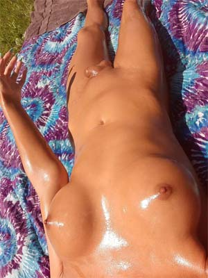 Naked Sunbathing with oiled shemale in Carson City, NV